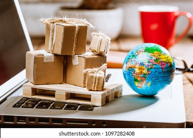 Global logistics concept with online trading and shopping in the internet, packages to be delivered after ordering on the computer