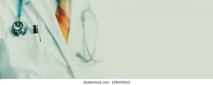Global medicine And Health care Concept. Unrecognizable Doctor With Stethoscope soft focus toned image