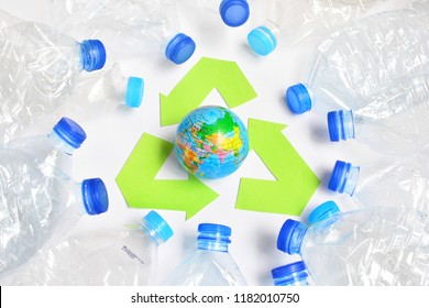 global model and recycle symbol on white background for concept recycling and reuse save the world
