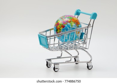 Global shopping concept. Globe on the shopping cart.