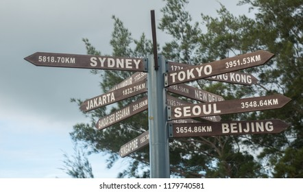 Global signpost for traveller guide - world distances measured from Tip of Borneo, Sabah Malaysia. selective focus.