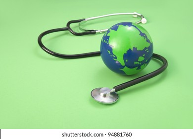 global and stethoscope  on a green background