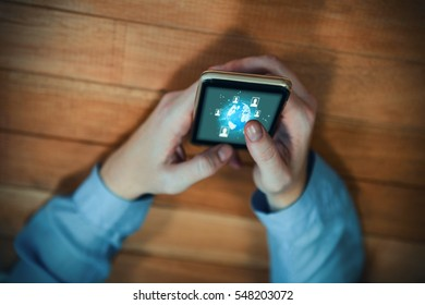 Global technology background against businesswoman text messaging while holding mobile phone