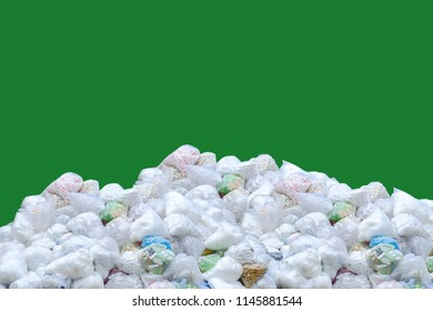 Global trash problem, Pile of plastic bag and bottles with green screen and clipping path.
