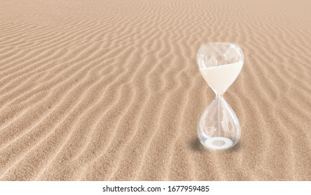 Global Warming Concept - Hourglass on a sand dune beach