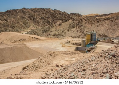 global warming and environmental pollution concept photography of awful abandoned and disabled rusty industrial factory with tank containers for some chemicals in desert quarry Middle East district