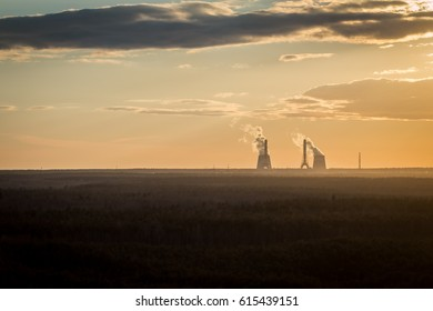 global warming. Factory pipe polluting air environmental problems ecology. the smoke from the chimney at sunset. Colorful dramatic sunset in industrial zone of city. Silhouettes chimneys with smoke.