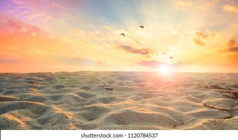 Global warming concept: sand dunes under dramatic evening sunset sky at drought desert landscape