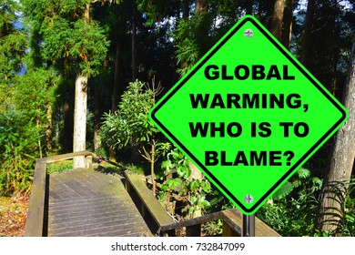 Global warming, who is to blame? Green road sign.