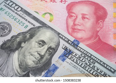 Global world economy crisis situation, US vs China trade war and currency war concept. US dollar and Chinese yuan renminbi banknotes background. US increases tariffs of Chinese goods.