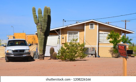 GLOBE ARIZONA APRIL 12 2014: Desert house with a giant saguaro cactus
