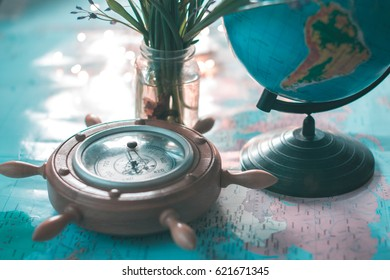 Globe and barometer on the map against the background of garlands