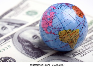 a globe and cash close up