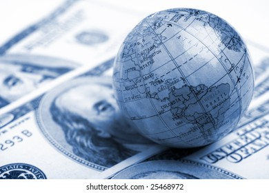 a globe and cash closeup