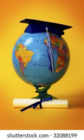 Globe with diploma