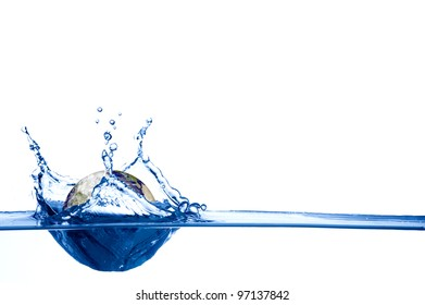 Globe drop in blue water with shallow depth of field isolated on white background