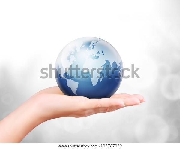 Globe ,earth in human hand against