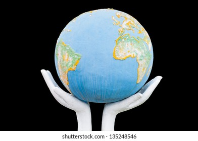 Globe ,earth in human hand on black background