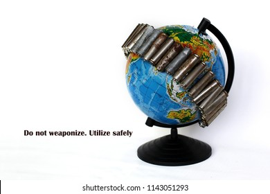 A globe of the earth with used batteries on it over white background, ecological problem concept, save the earth, utilize safely. Message for social advertising, place for text