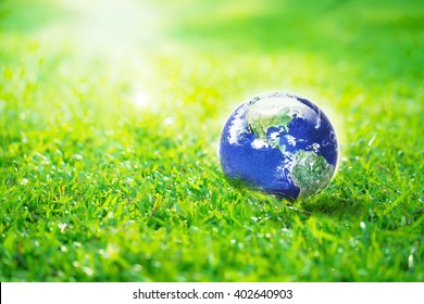Globe in the garden, Earth on green grass eco concept, Elements of this image furnished by NASA