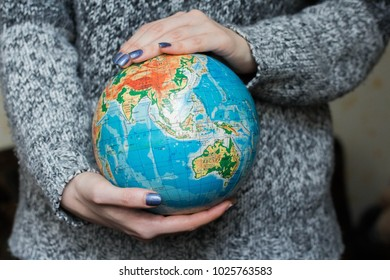 globe in hands. Girl holding planet Earth in hands