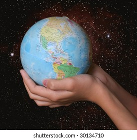 globe in hands on space background