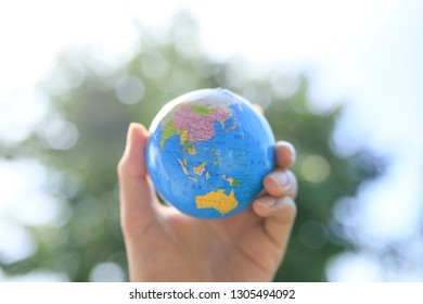 The globe and human hand