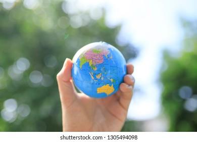 The globe and human hand