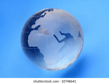 globe isolated on blue background with reflection