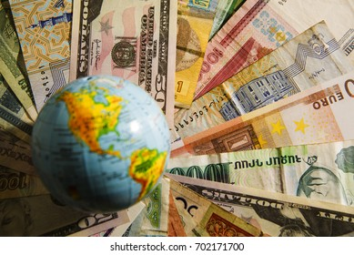 Globe map sign over many american dollar bank notes and bills of different states. international banknotes. globe on various  money bill