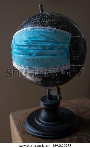 Globe model with medical mask.