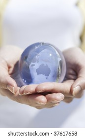 A globe on the female both hands.