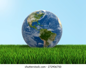 Globe on grass (clipping path included) Elements of this image furnished by NASA