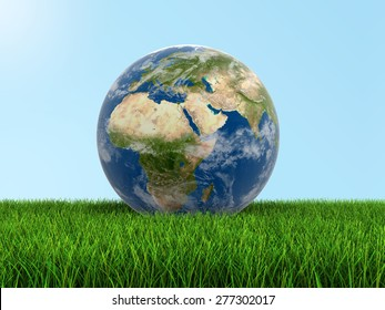 Globe on grass Elements of this image furnished by NASA