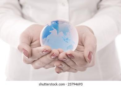 Globe on hands businesswoman hands