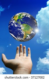globe of planet earth above a man hand