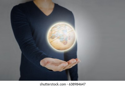 Globe spinning and glowing holding by hand