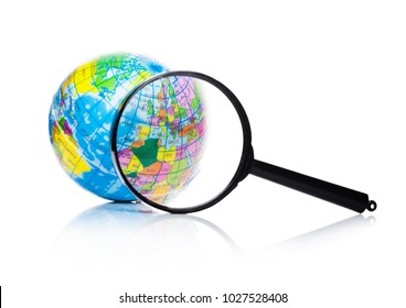 Globe under magnifying glass zooming Europe and Africa on white background