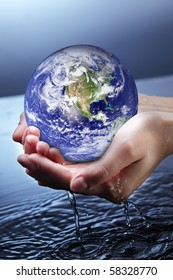 globe in woman hand