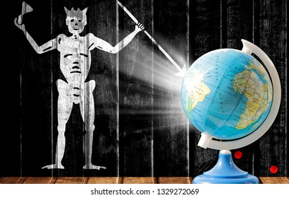 Globe with a world map on a wooden background with the image of the flag of Blackbeard Pirate. The concept of travel and leisure abroad.