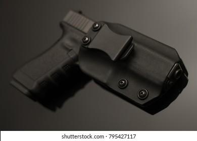 Glock 17 in IWB holster on glass