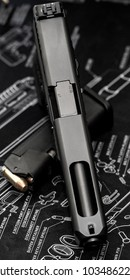 Glock 35 handgun with a magazine from different angles
