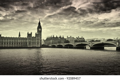 Gloomy and dark image of Houses of Parliament and Westminster bridge