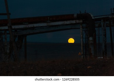 Gloomy moonrise over the mountain in the industrial zone, August, 26, 2018, Norilsk Kayerkan