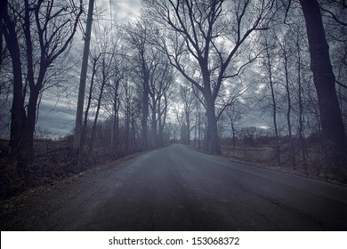 Gloomy road durring a cold and dark day of Autumn
