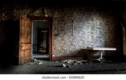 Gloomy room sits unfound for decades. Built up dust lay untouched on furniture. Murder scene unseen for a long time.