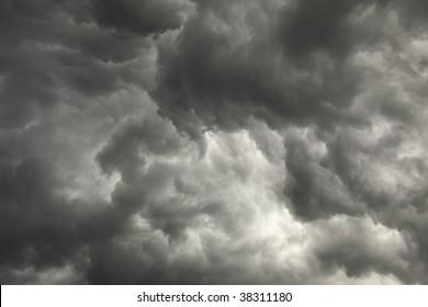 The gloomy sky preceding a storm with dark clouds background