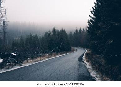 Gloomy weather and rain clouds in the Harz Mountains on the Brocken mountain. Street to the top