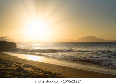 Glorious, dramatic, sunset on the shoreline at Puerto Plata, Dominican Republic