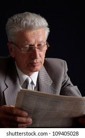 Glorious elderly man in suit on black background
